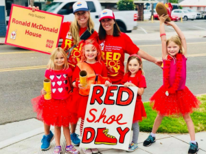 four girls and two moms volunteer on Red Shoe Day