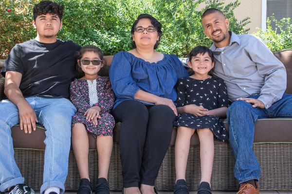 Raymundo family seated