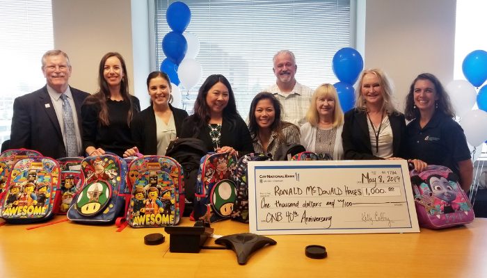 City National Bank representatives and donated backpacks